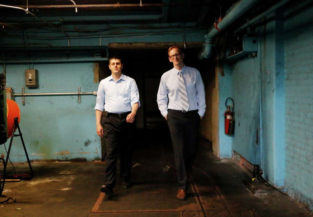 Chief Executive Officer Seth Rosenblum and Executive Vice President Jeffrey Mirel of Rosenblum walk through the basement of the Troy Record building which is being proposed for apartments on Monday, August 3, 2015, in Troy, N.Y. The developer went to the county economic development arm when it didn't like the tax breaks the city was offering (Olivia Nadel/ Special to the Times Union)