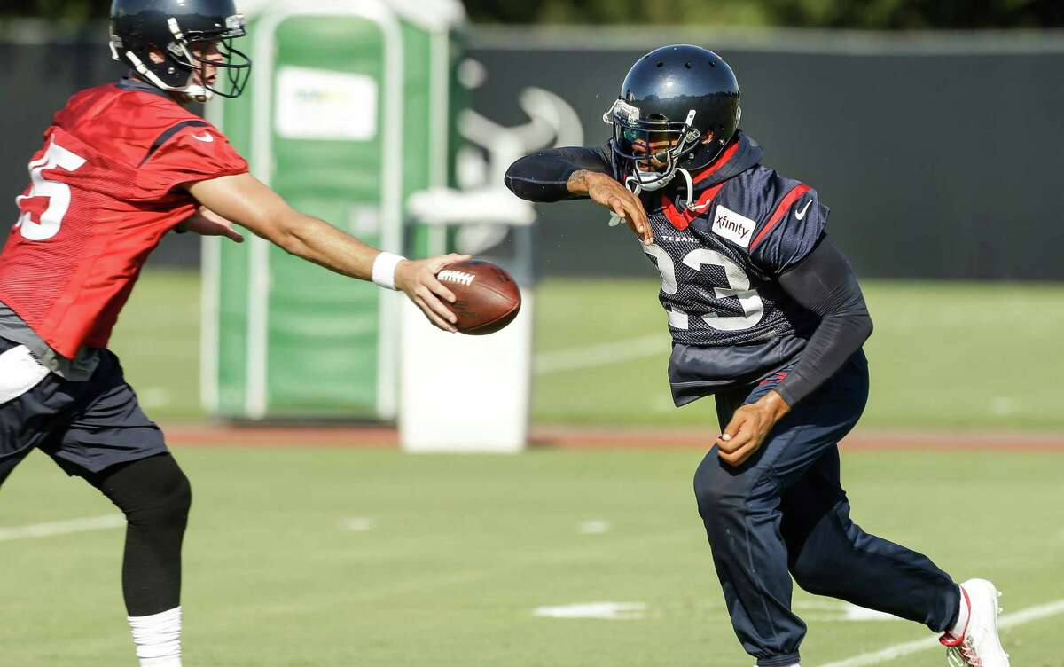 Houston Texans running back Arian Foster (23) takes a handoff from quarterback Ryan Mallett (15) during Texans training camp at the Methodist Training Center Sunday, Aug. 2, 2015, in Houston.