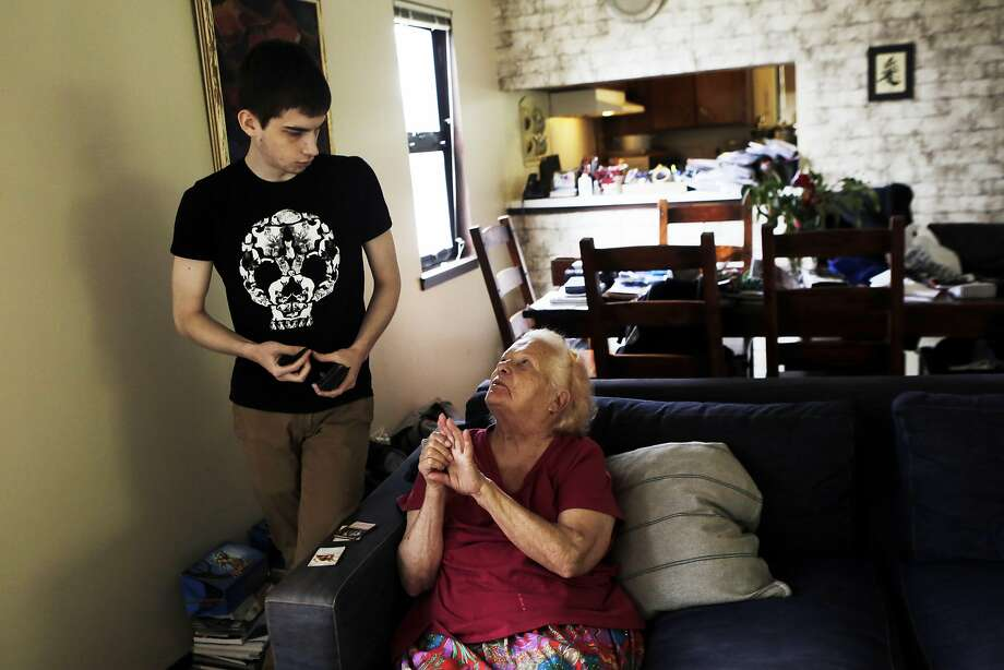 Tani Kulikov, 21, shares a moment with his grandmother Stefanka Tchobanksa, 76, in their Yerba Buena Island home on Friday, July 31, 2015. Yerba Buena residents are being forced out of their homes due to the development of new condominiums on the Island. Photo: Dorothy Edwards, The Chronicle