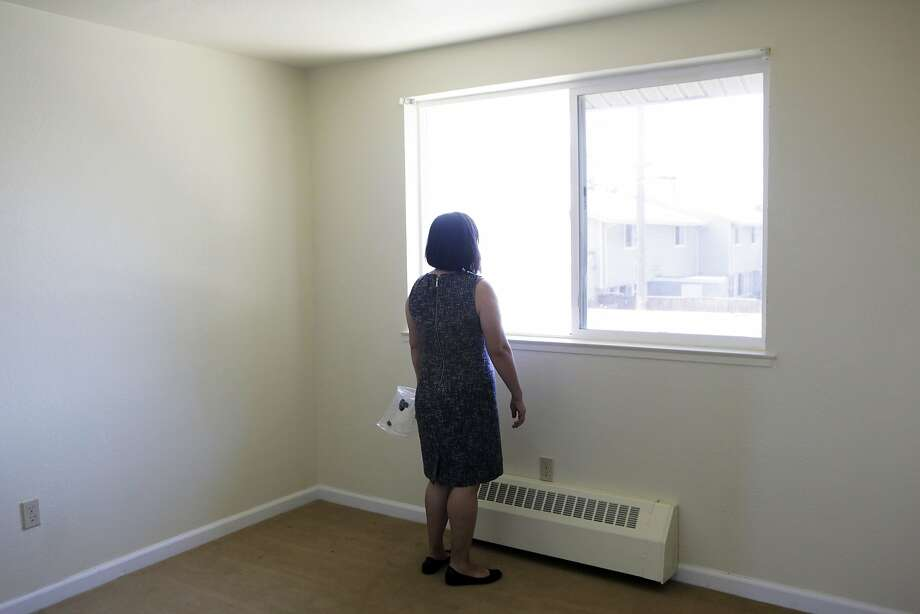 "Betty Mackey of Yerba Buena Island looks out of the window of the unit she is assigned to for relocation on Treasure Island, Ca. on Wednesday, July 29, 2015. Residents on Yerba Buena Island are being evicted due to the development of new condominiums on the island. ""I am constantly nagged with this on my mind and my heart,"" Mackey says of the eviction. ""It has been really hard."" Photo: Dorothy Edwards, The Chronicle"