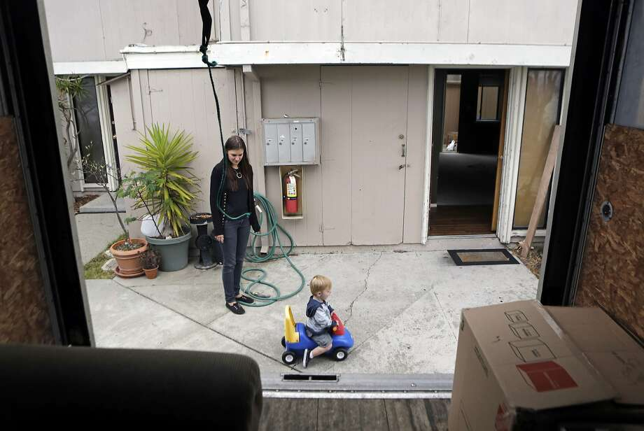 Tamara Farley shares a moment with her son Jameson while moving out of their house on Yerba Buena Island. Residents are being forced out of their homes to make room for condos, a hotel, and ferry terminal. Photo: Dorothy Edwards, The Chronicle