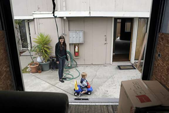Tamara Farley shares a moment with her son Jameson Cooksey, 1, while moving out of their house on Yerba Buena Island on Thursday, July 30, 2015. Residents are being forced out of their homes due to the development of new condominiums on the Island.