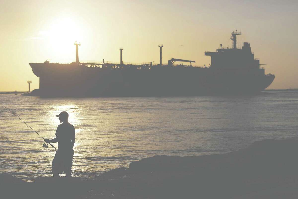 An oil tanker enters a channel near Port Aransas as it heads for the Port of Corpus Christi. Oil futures slid on Monday amid fears of softer demand.