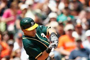 A's Drumbeat: A closer look at today's transactions - Photo