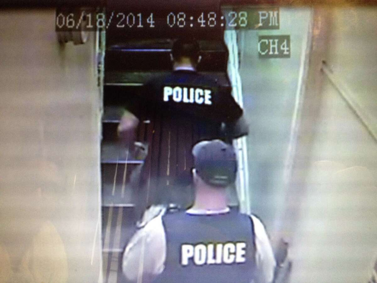 Albany Detective Scott Gavigan, wearing baseball hat, and Sgt. Richard Gorleski enter the Central Avenue apartment of a drug suspect without a search warrant last June.