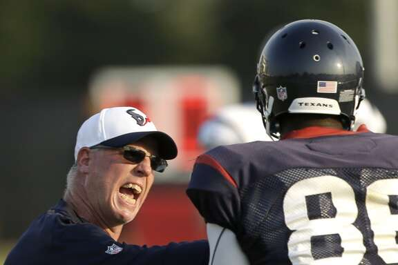 Houston Texans tight ends coach John Perry works with tight end Khari Lee (86) during Texans training camp at the Methodist Training Center Monday, Aug. 3, 2015, in Houston.  ( Brett Coomer / Houston Chronicle )