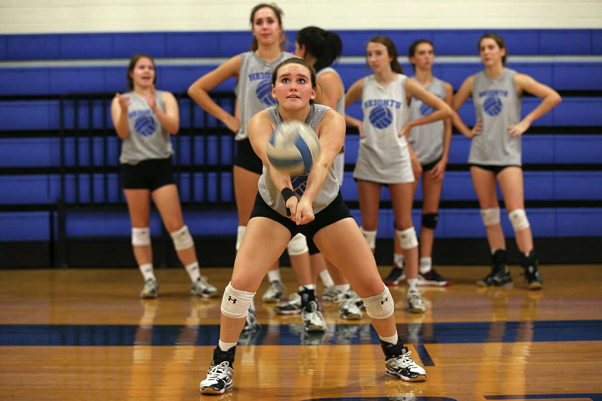 Mariela Gonzalez goes through a drill during the first day of volleyball practice for Alamo Heights. The Mules were 42-7 last season, the best season in school history, and advanced to the Region IV-4A final.