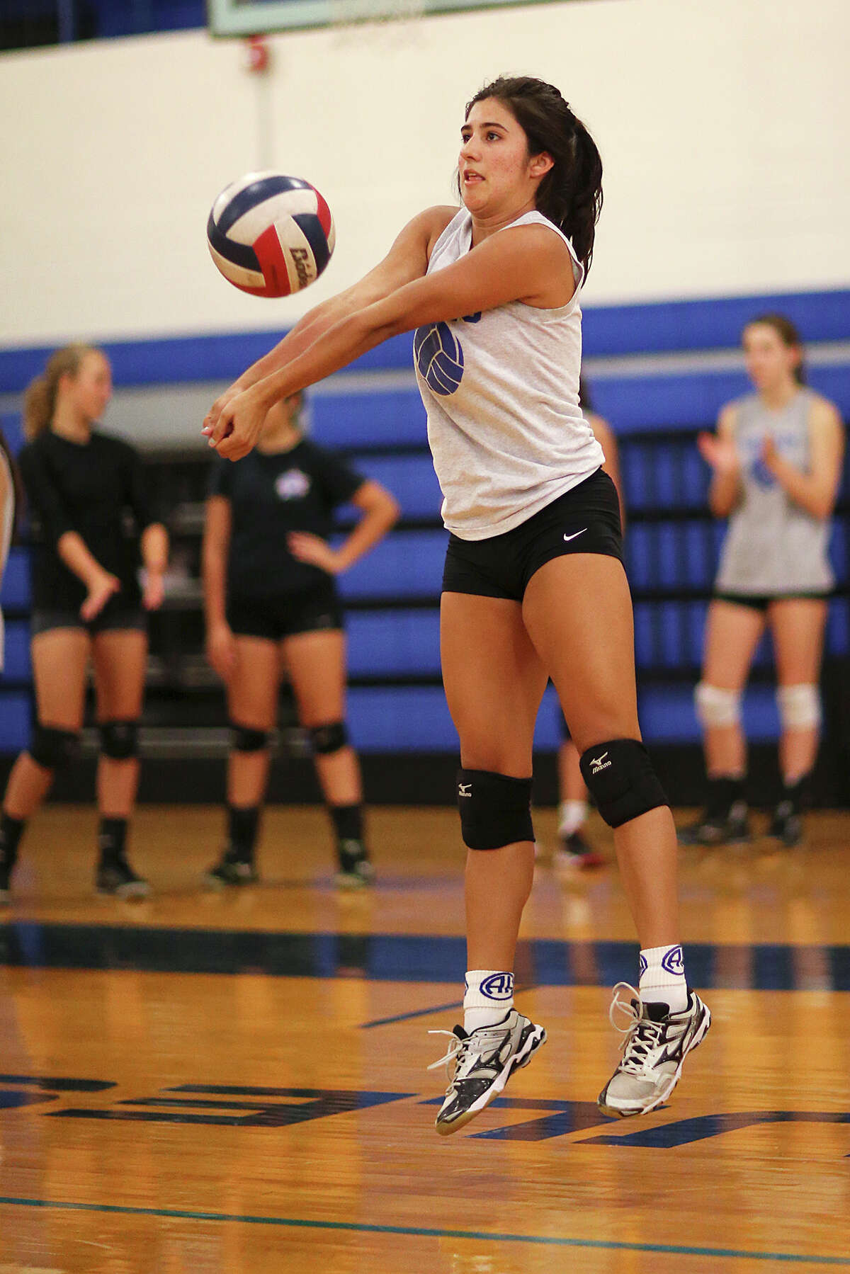 Alamo Heights High School volleyball team member Hannah Lackey goes through a drill during the first day of practice at the Muledome, Monday, August 3, 2015.