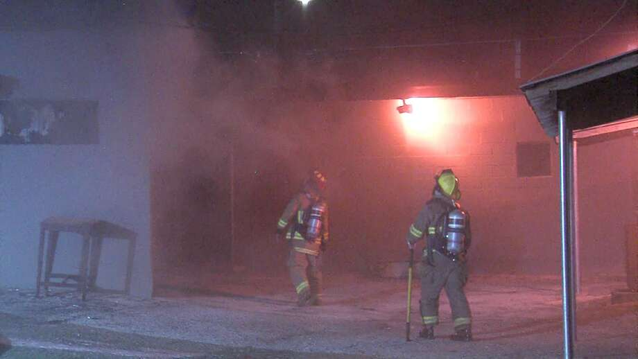 Investigators are working to determine the cause of a fire that torched a North Side shopping center Tuesday morning. Photo: 21 Pro Video