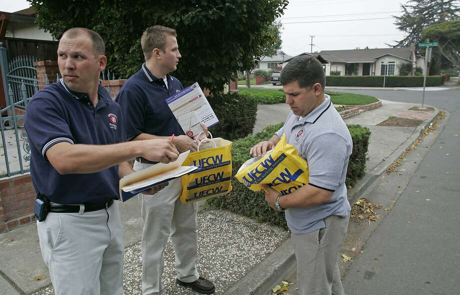 In this 2005 file photo, Hayward firefighter Garrett Contreras, left, and firefighters Jason Livermore and Frank Saiz, plot out their course of action for talking with residents about several propositions on the ballot. Contreras, now Hayward's fire chief, was suspended but allowed to continue with his job after a number of behavioral issues that include drinking while on call. Photo: Michael Macor, The