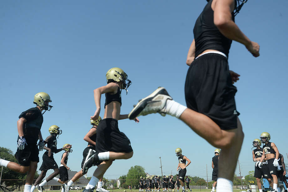 Nederland High School runs drills as the Bulldogs get ready for the coming season on the opening day of football practice Monday.  Photo taken Monday, August 3, 2015 Kim Brent/The Enterprise Photo: Kim Brent / Beaumont Enterprise