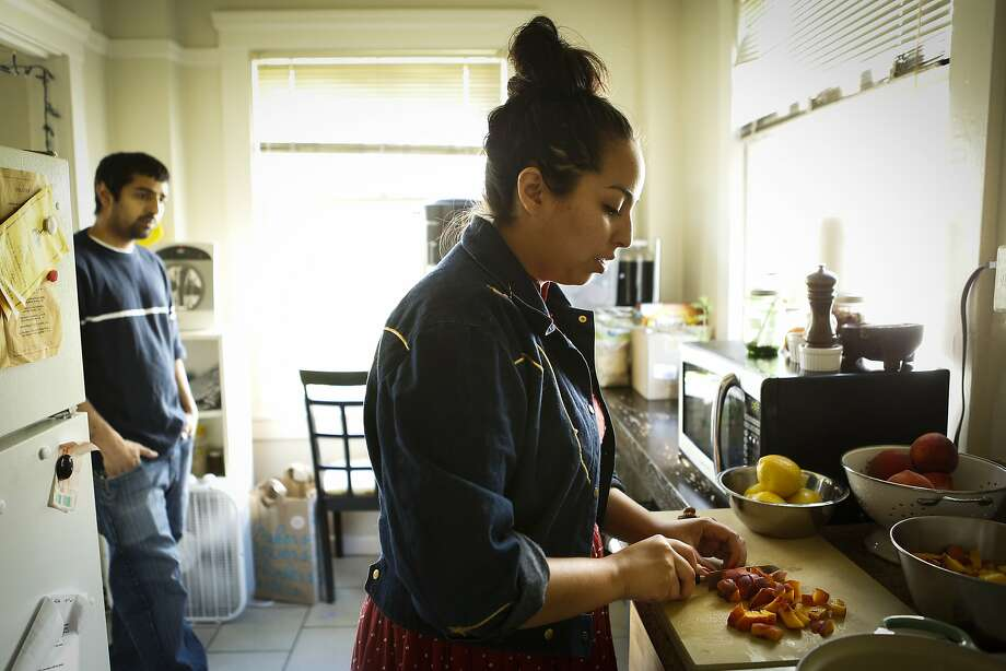 Stephany Gocobachi (right) and Akhil Khadse of S.F. company Flour Child make a small batch of their Peach Jam. Photo: Russell Yip, The Chronicle