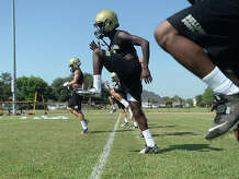 Nederland High School runs drills as the Bulldogs get ready for the coming season on the opening day of football practice Monday.  Photo taken Monday, August 3, 2015 Kim Brent/The Enterprise