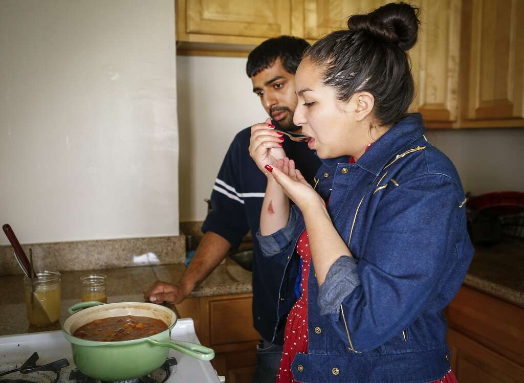 Stephany Gocobachi and Akhil Khadse of Flour Child taste test a batch of Peach Jam. Photo: Russell Yip, The Chronicle