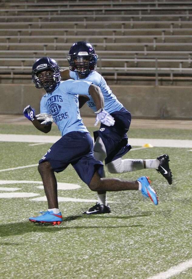 Clements High School football players go through defensive drills during the Midnight Madness practice at Mercer Stadium in Sugar Land on August 3, 2015 Photo: Diana L. Porter, For The Chronicle / © Diana L. Porter