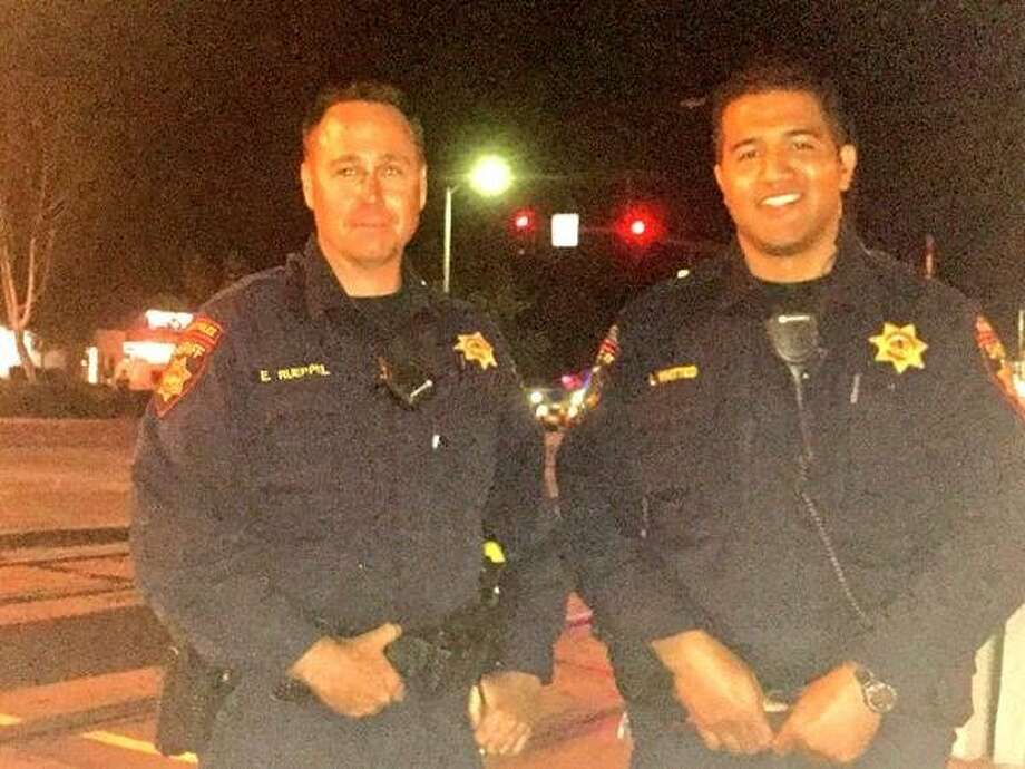 San Mateo County sheriff's deputies Erik Rueppel (left) and Lance Whitted helped save the life of a man whose car was found on the tracks in Sunnyvale Photo: Caltrain