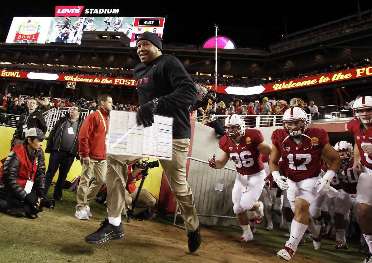 Stanford head coach David Shaw and the team enter the field at the beginning of the Foster Farms Bowl on Tuesday. Stanford Cardinal played the Maryland Terrapins at Levi's Stadium in Santa Clara, Calif., in the 2014 Foster Farms Bowl on Tuesday, December 30, 2014.