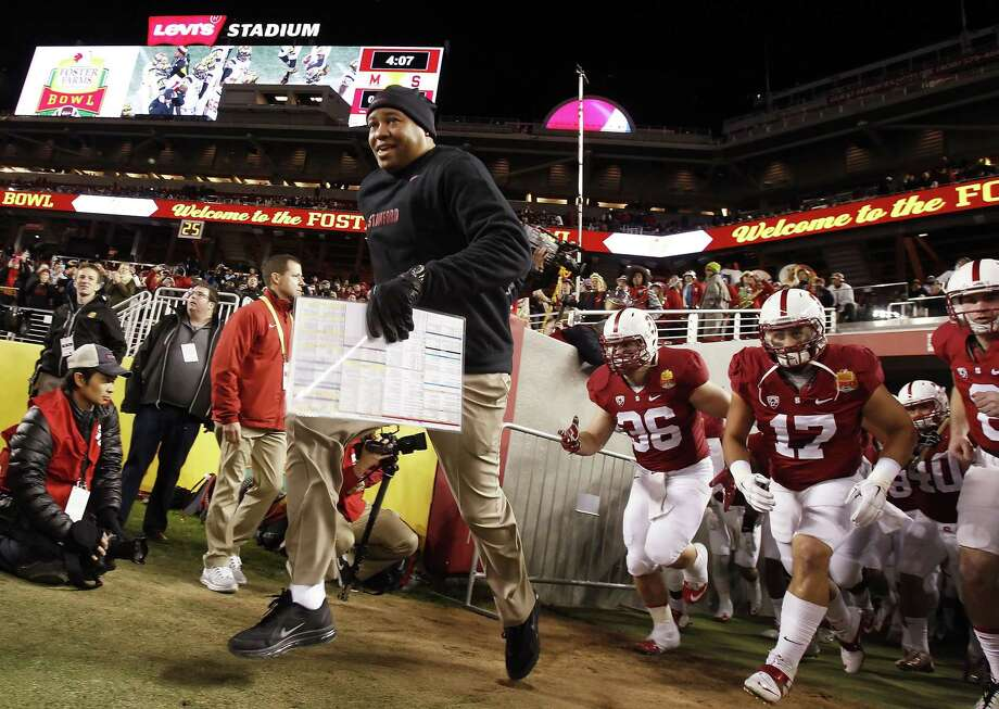 Stanford head coach David Shaw and the team enter the field at the beginning of the Foster Farms Bowl on Tuesday. Stanford Cardinal played the Maryland Terrapins at Levi's Stadium in Santa Clara, Calif., in the 2014 Foster Farms Bowl on Tuesday, December 30, 2014. Photo: Carlos Avila Gonzalez /San Francisco Chronicle / ONLINE_YES