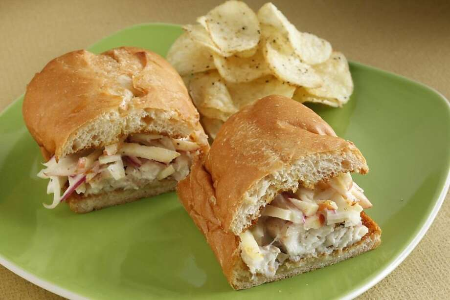 Mild-fleshed white fish like sole, tilapia or rockfish works best in this sandwich, which gets a punch of flavor from a crunchy, sweet-tart apple slaw. Make the slaw first, so the flavors will blend while you're preparing the fish. Photo: Craig Lee /Special To The Chronicle