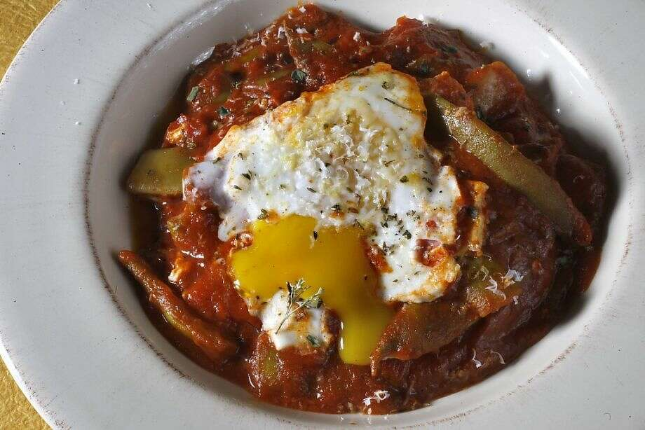 Braised Romano Beans with Soft-Cooked Eggs takes a bit of time to cook, but there's very little hands-on prep involved. Photo: Liz Hafalia /The Chronicle