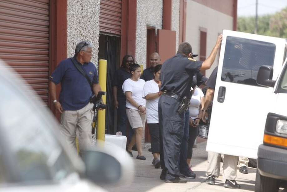 Federal agents conducted a raid at  about 10 a.m. Tuesday, Aug. 4, 2015 at La Espiga de Oro tortilla factory at 1200 15th Street near Shepherd. Photo: Cody Duty | Houston Chronicle