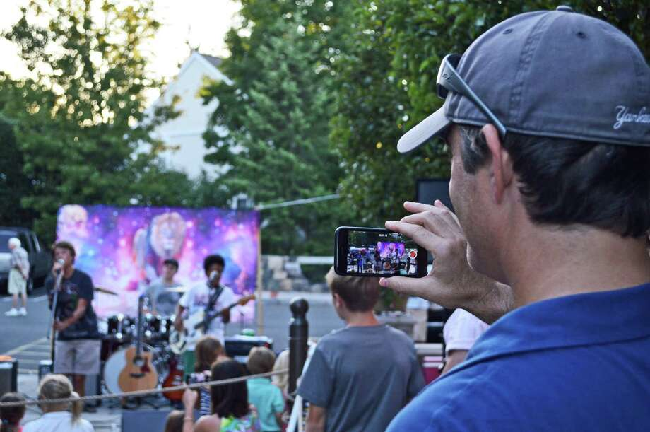 Diego Winegardner of Greenwich watches his son, Mick, 13, performing with Lions of the Moon. PHOTO BY JARRET LIOTTA Photo: Contributed / Jarret Liotta / Darien News