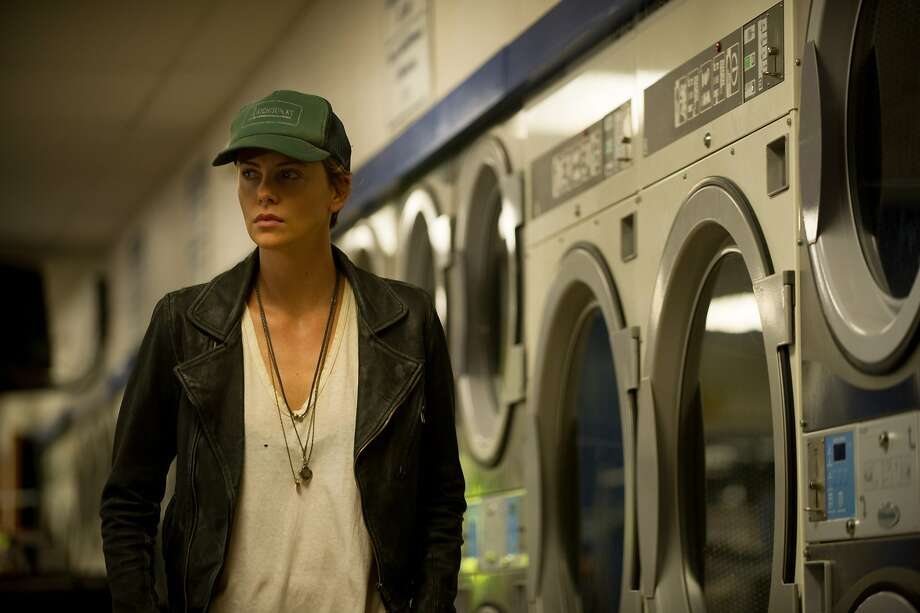 "Libby Day (Charlize Theron) investigates the decades-old murder of her family in ""Dark Places"" — did her brother really commit the crime or was he wrongfully convicted? Photo: A24 Films"