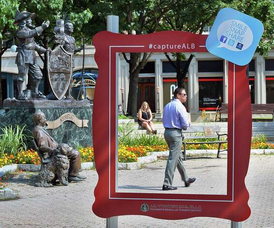 A big red picture frame encourages visitors to participate in a social media campaign at Tricentenial Park Tuesday August 4, 2015 in Albany, NY. (John Carl D'Annibale / Times Union) Photo: John Carl D'Annibale