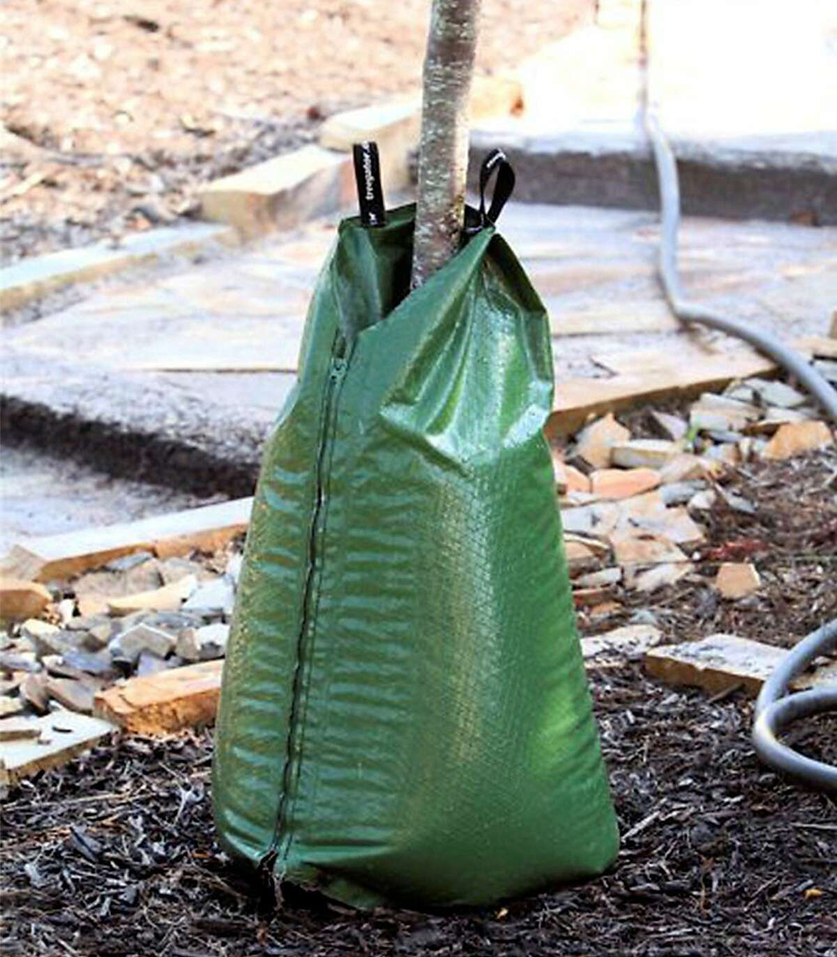 Treegator® Slow Release Watering Bag is a slow release watering system for newly planted trees. The Treegator® Original slowly and evenly delivers a high volume of water directly to the root system of a newly planted tree or shrub with no run-off or evaporation.