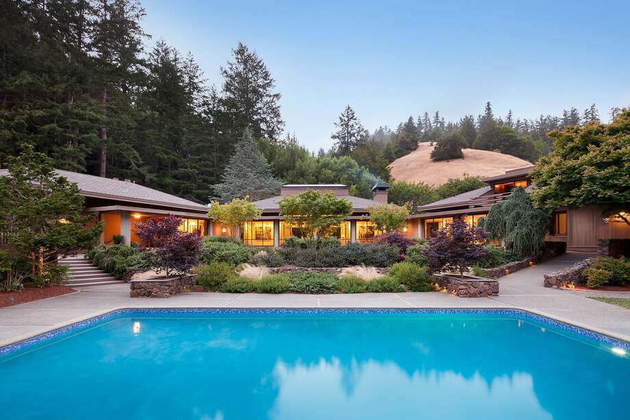 The 48-acre lot amidst tree-studded hills includes a pool.