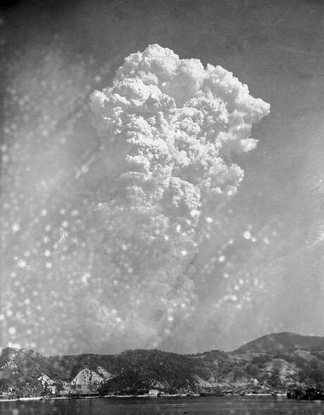 Smoke rises over Hiroshima after the first atomic bomb. Photo: Associated Press