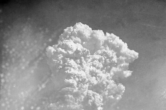 FILE- In this Aug. 6, 1945, file photo, smoke rises around 20,000 feet above Hiroshima, Japan, after the first atomic bomb was dropped. On two days in August 1945, U.S. planes dropped two atomic bombs, one on Hiroshima, one on Nagasaki, the first and only time nuclear weapons have been used. Their destructive power was unprecedented, incinerating buildings and people, and leaving lifelong scars on survivors, not just physical but also psychological, and on the cities themselves. Days later, World War II was over. (AP Photo, File)