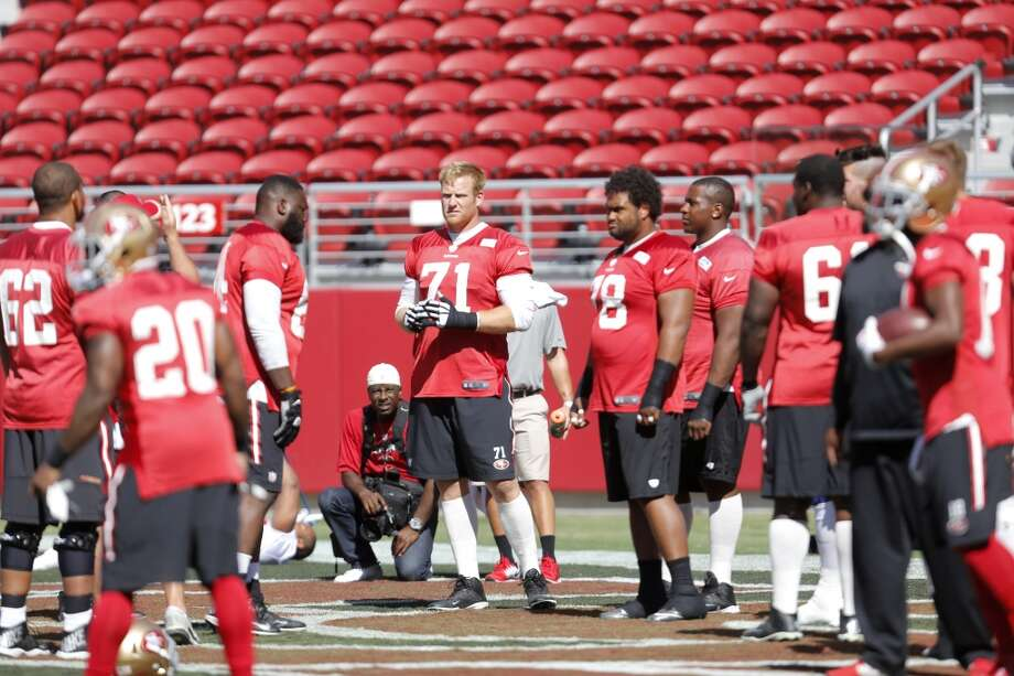 Offensive lineman Erik Pears (center) watches warmups during 49ers practice at Levi's Stadium in Santa Clara, California, on Sunday, Aug. 2, 2015. Want to know the cost to attend a 49ers game this season? Photo: The Chronicle
