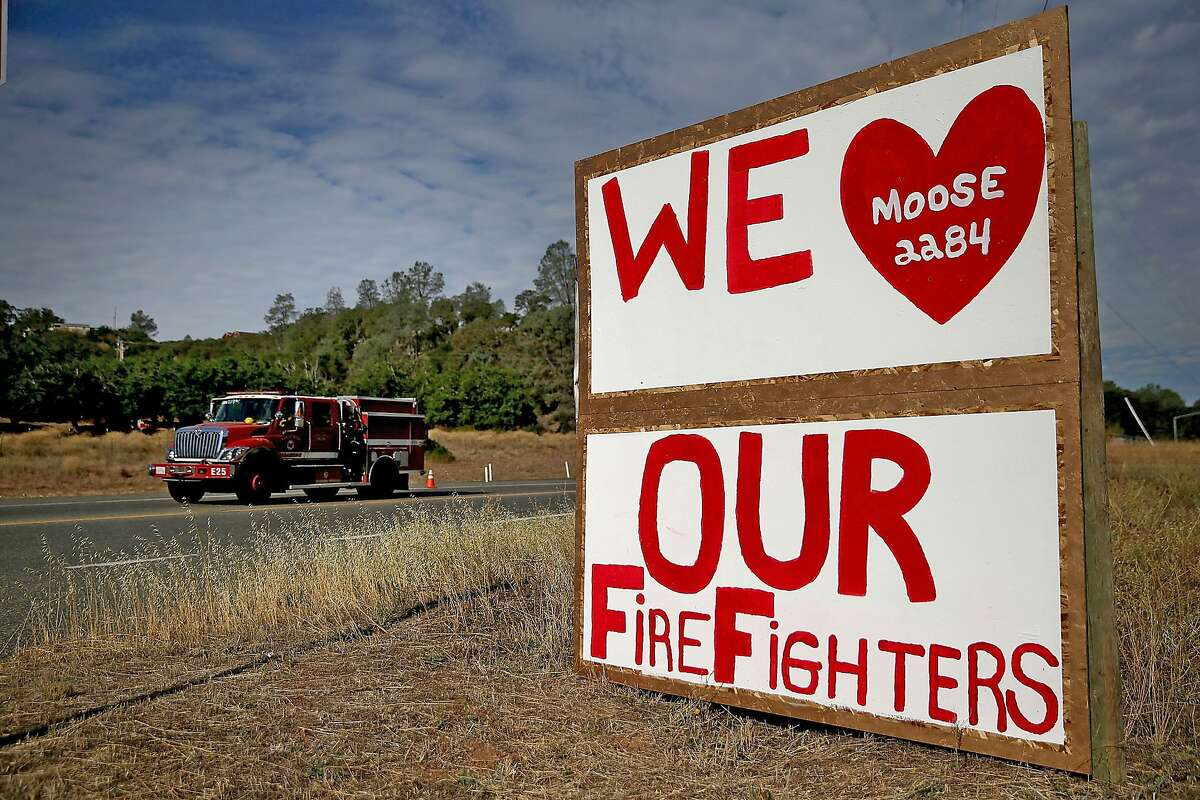 A sign thanking firefighters who are battling the Rocky Fire is posted in front of the Moose Lodge on August 4, 2015 in Clearlake Oakes, California. Nearly 3,000 firefighters are battling the Rocky Fire that has burned 65,000 acres and forced the evacuation of 12,000 residents in Lake County. The fire is currently 12 percent contained and has destroyed at least 14 homes. 6,300 homes are threatened by the fast moving blaze.