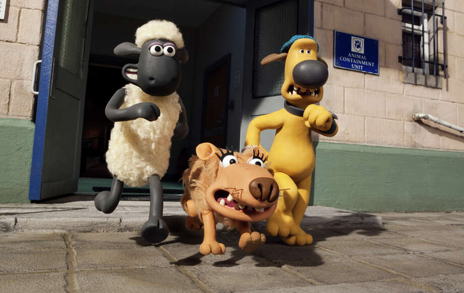 Shaun (voiced by Justin Fletcher), Slip (Tim Hands) and Bitzer (John Sparkes) evade animal control.