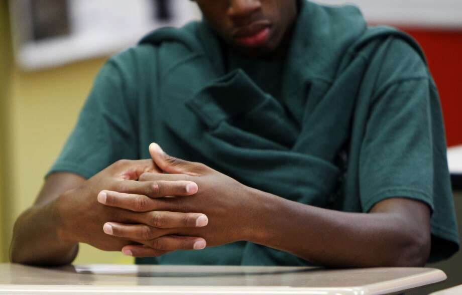 A young man of Camp Sweeney rests his hands on his desk during class at Freedom School, a summer program at Camp Sweeney Academic Center, in San Leandro, Ca. on Tuesday, Aug. 4, 2015. Photo: Dorothy Edwards, The Chronicle