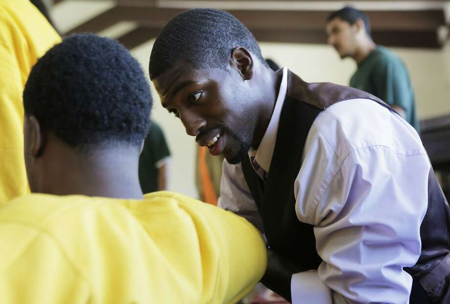 "Juvenile Justice Delinquency Prevention Commissioner Tony Robinson speaks to a young man of Camp Sweeney during the morning pep rally or ""Harambee"" as a part of Freedom School, a summer program at Camp Sweeney Academic Center, in San Leandro, Ca. on Tuesday, Aug. 4, 2015. Photo: Dorothy Edwards, The Chronicle"