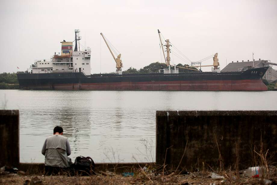 A journalist sits near the North Korean cargo ship Mu Du Bong, anchored in Tuxpan, Mexico. Photo: Felix Marquez, Associated Press
