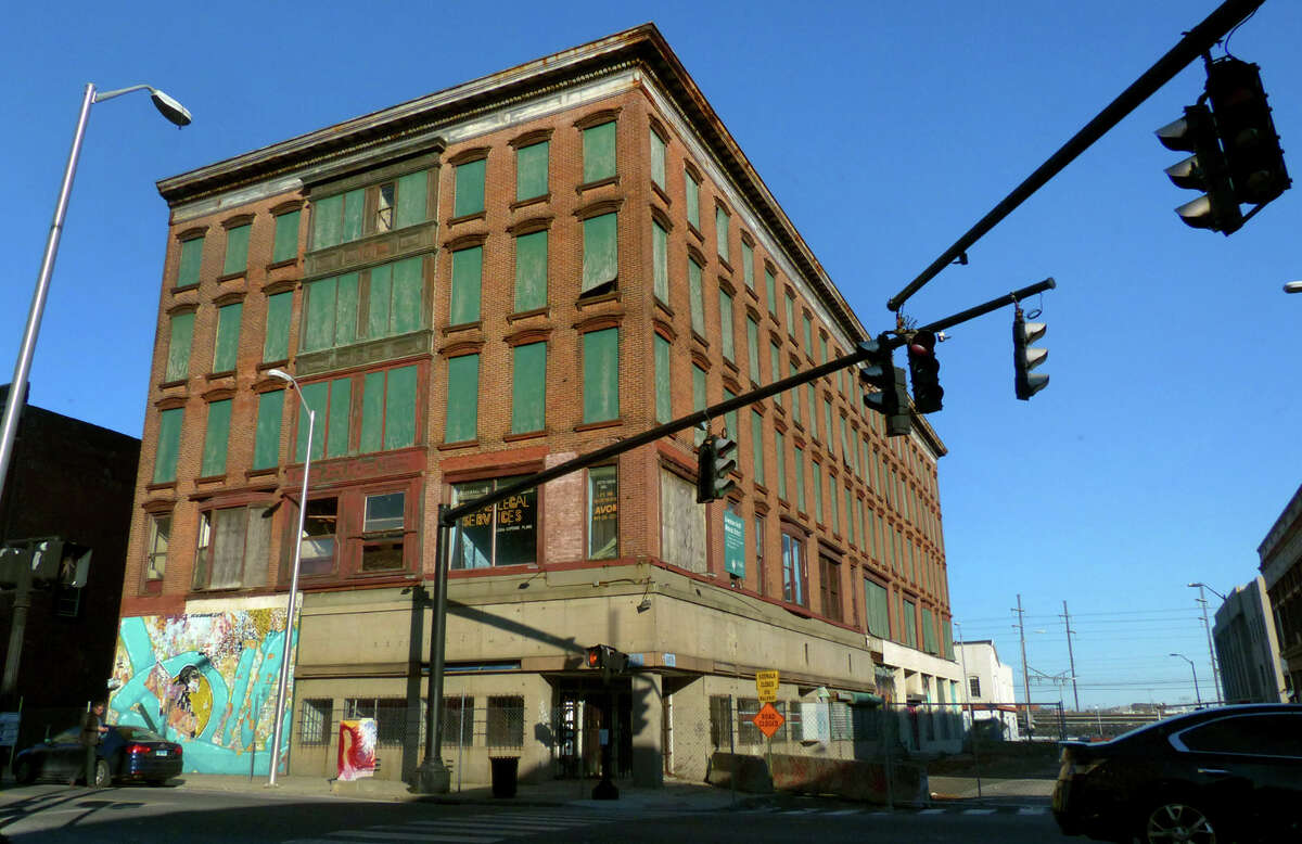 Reconstruction at the Jayson-Newfield Building on Main and Golden Hill streets in Bridgeport has come to a halt over a dispute between the developer and a contractor.