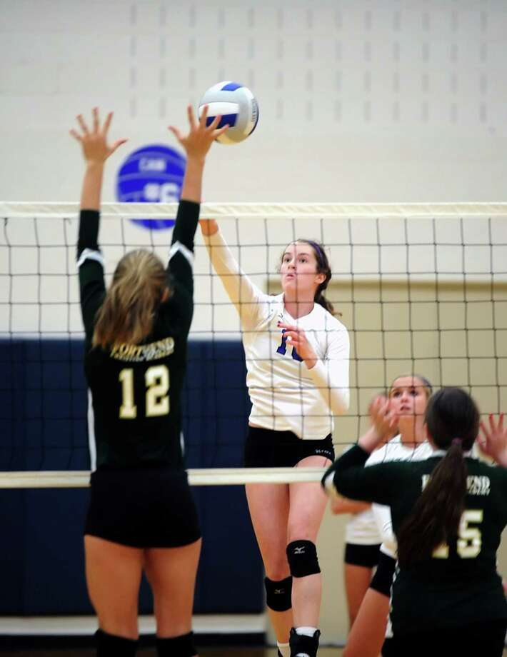 Fort Bend Christian High School volleyball team traveled to Episcopal High School for a volleyball match, 9-10-2013.  Right, Episcopal's Grace Geib (10) hits over the hands of Christian's Julia Smith (10). Photo: Eddy Matchette, Freelance / Freelance