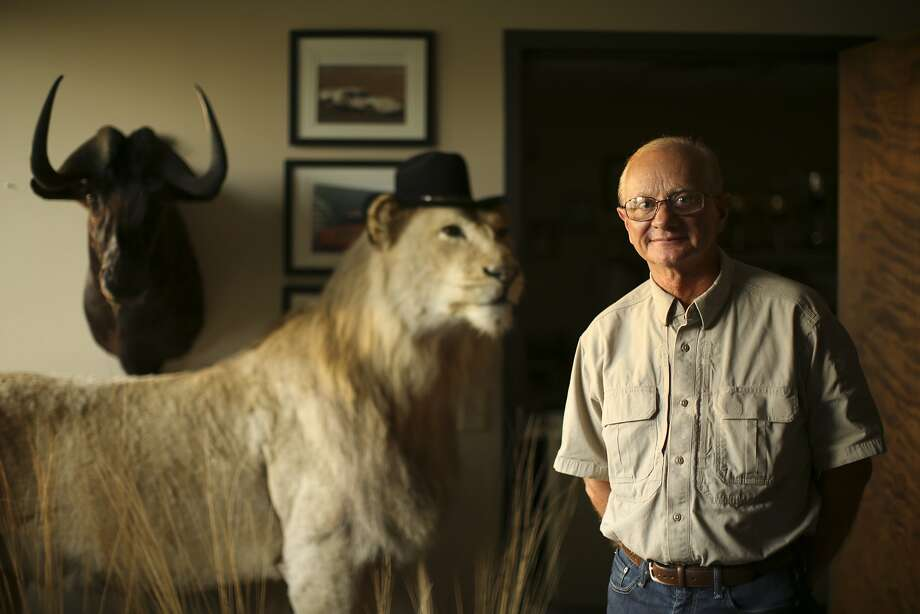 Jim Derhaag, a former race car driver, poses in his Shakopee, Minn., office with a lion and wildebeest he shot in Africa. Photo: Jeff Wheeler, McClatchy-Tribune News Service