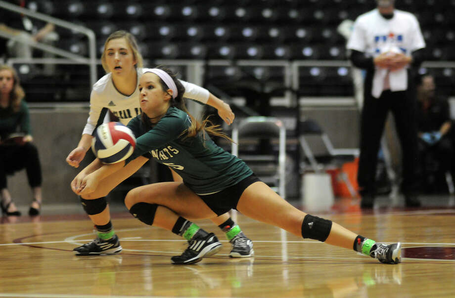 Clear Falls junior libero Madelyn St. Germain, right, makes a pass in front of teammate Sarah Hayman during their Class 6A state volleyball semifinal at the Curtis Culwell Center in Garland on Friday. Photo: Jerry Baker, Freelance