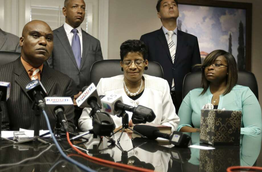 Attorney Cannon Lambert (left); Sandra Bland's mother, Geneva Reed-Veal; and sister Sierra Cole address the press. Photo: Pat Sullivan, Associated Press