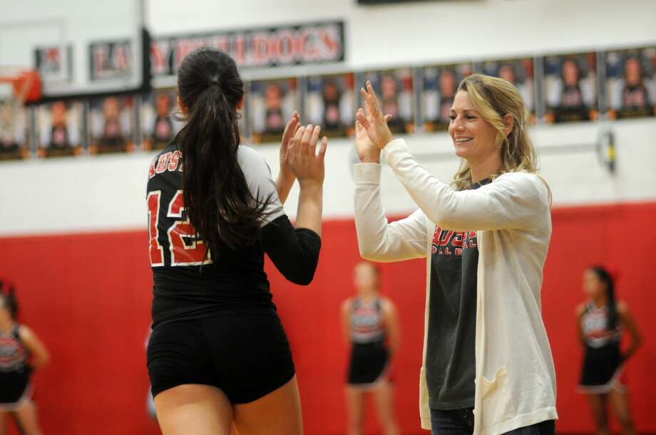 Fort Bend Austin head coach Amy Cataline, right, and outside hitter Paige Swinney are setting high standards for the Bulldogs this season. Photo: Jerry Baker, Freelance