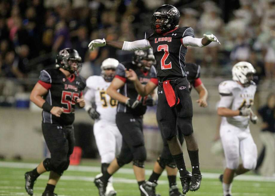 Langham Creek wide receiver Quartney Davis (2) is among the key returnees for the defending District 17-6A champion Lobos. Photo: J. Patric Schneider, Freelance / © 2014 Houston Chronicle