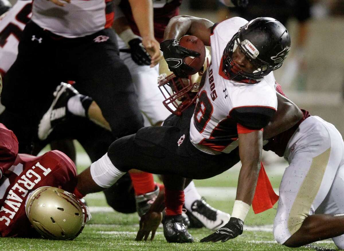 Langham Creek running back Toneil Carter dives for extra yards during the first half of a high school football game against Cypress Woods at the Berry Center on Friday, Oct. 17, 2014, in Cypress. (J. Patric Schneider / For the Chronicle )