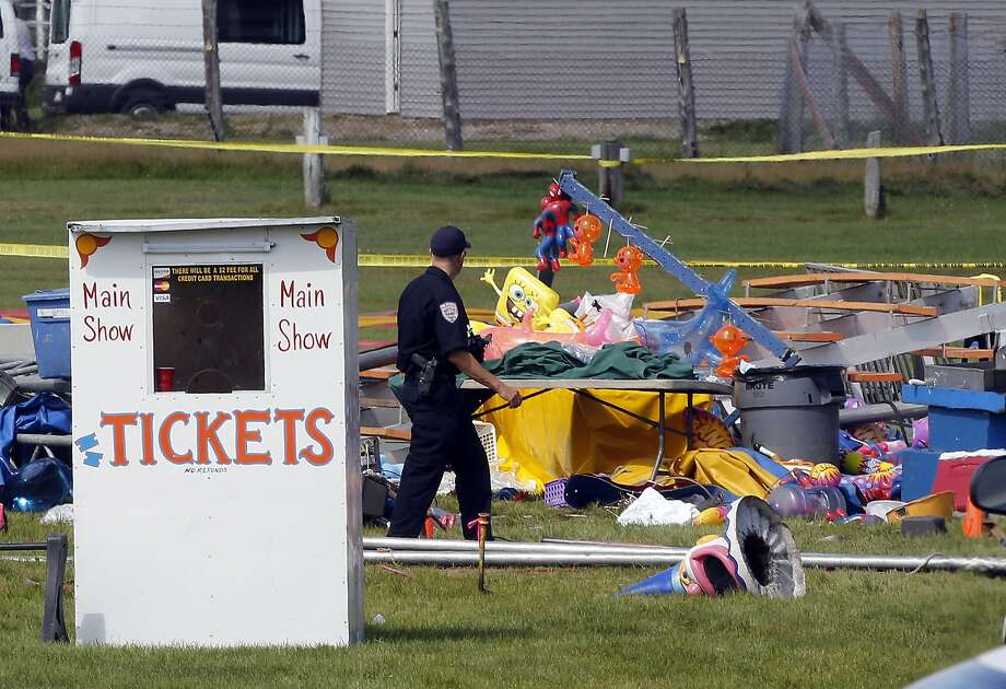 Investigators investigate after 60 mph winds hit a circus tent shortly after the show started killing a father and daughter. Photo: Jim Cole, Associated Press