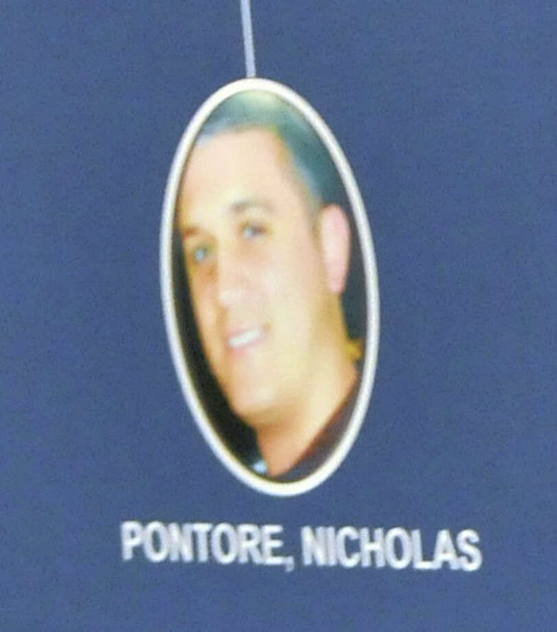 A photo of Nicholas Pontore is displayed during a press conference on Tuesday, August 4, 2015, at The New York State Police Academy in Albany, N.Y. (Phoebe Sheehan/Special to The Times Union) Photo: PS / 10032893A