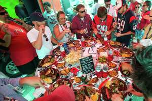 Judges sample the food inside the Battle Red Wagon Tailgaters tent during the Tailgate of the Game - Training Camp Edition competition at the Methodist Training Center Monday, Aug. 3, 2015, in Houston.