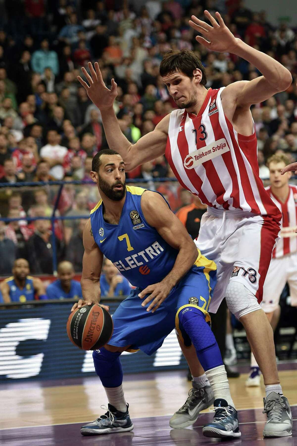 Boban Marjanovic, a 7-foot-3 center who signed a one-year, $1.2 million deal with the Spurs in July, will be barred from this summer's FIBA Eurobasket competition due to an ankle injury. Maccabi Tel Avivs US forward Brian Randle (L) vies with Red Star Belgrade's center Boban Marjanovic during the Euroleague Top 16 basketball match between Crvena Zvezda Belgrade and Maccabi Electra Tel Aviv in Belgrade on March 5, 2015. AFP PHOTO / ANDREJ ISAKOVIC (Photo credit should read ANDREJ ISAKOVIC/ AFP/Getty Images)